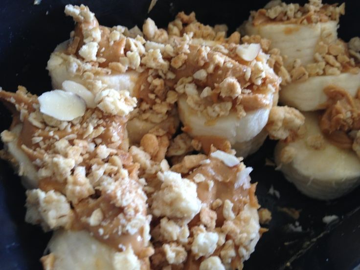 Banana + peanut butter + granola Sweet, energy boosting snack!