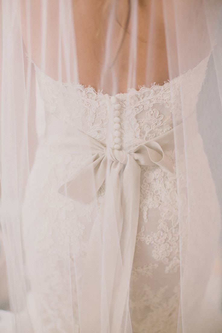 Sweet bow + lace dress | Photography: Dave Richards Photography - dave-richards.com  Read More: http://www.stylemepretty.com/little-black-book-blog/2014/05/15/elegant-la-venta-inn-wedding/