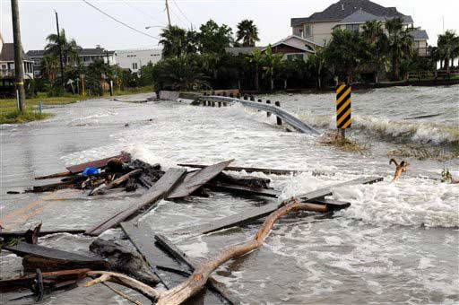 Long Before Landfall  Credit: AP Photo/Kim Christensen  The storm surge from Hurricane Ike and debris covers a street, Friday, Sept 12, 2008 in Seabrook Texas. Incredibly, Ike s center was still some 200 miles away when this photo was taken.
