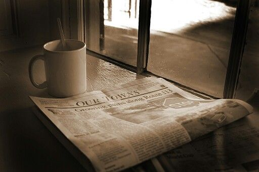 Reading the newspaper and a good cup of coffee!