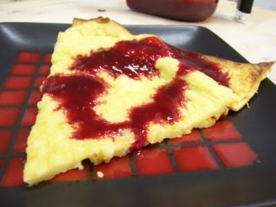 Oven Baked Pancake with Homemade Raspberry Sauce