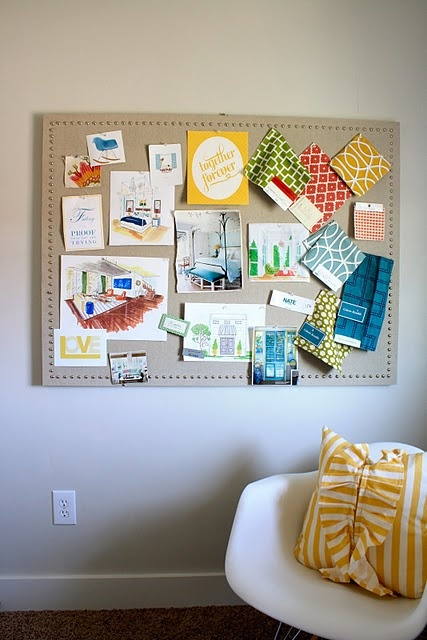 Sophisticated linen covered cork board. I love how the nailheads make it look high end.