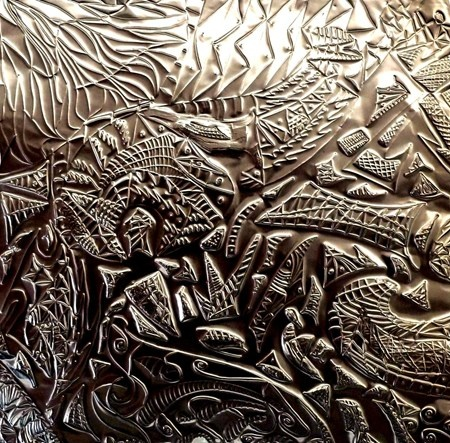 Repousse in tin