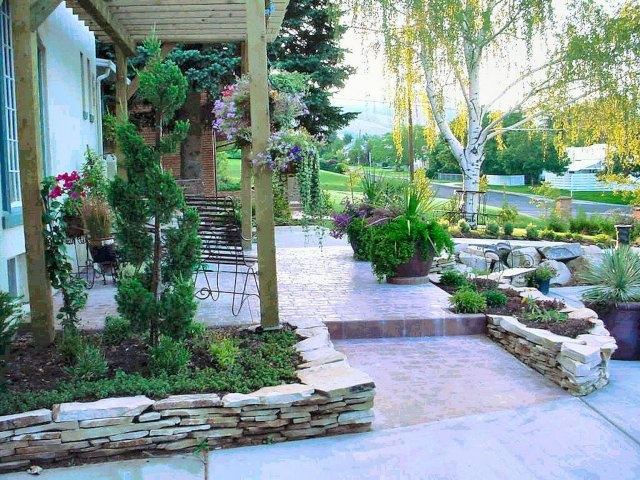 Stone Flower Bed : Raised, stacked-stone flower beds enhance the plantings and walks in a ...