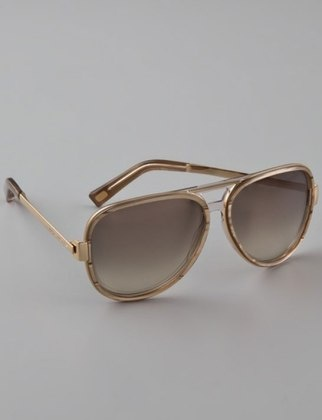 The smoky taupe color pairs perfectly with the classic aviator silhouette. Just masculine enough.  Marc Jacobs Aviator Sunglasses, shopbop.com
