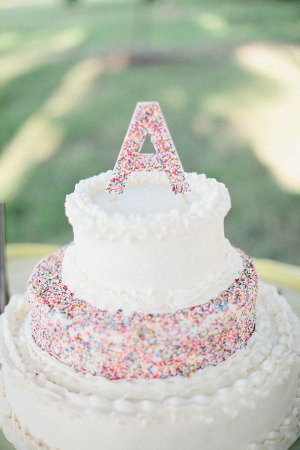 rainbow sprinkles wedding cake ideas http://www.weddingchicks.com/2013/10/24/colorful-eclectic-wedding/