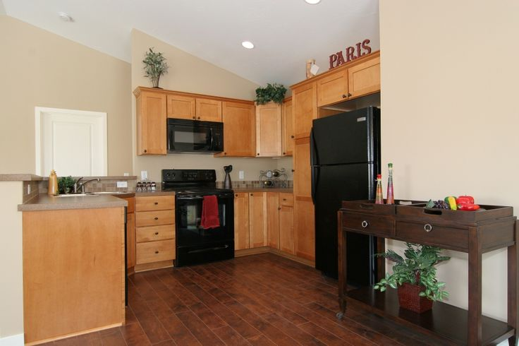 Dark floors w light cabinets  For the kitchen & dining room  Pinte