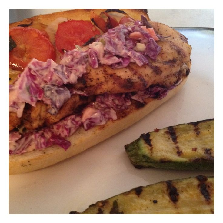 chicken sandwich with grilled tomatoes, onions, and red cabbage ...