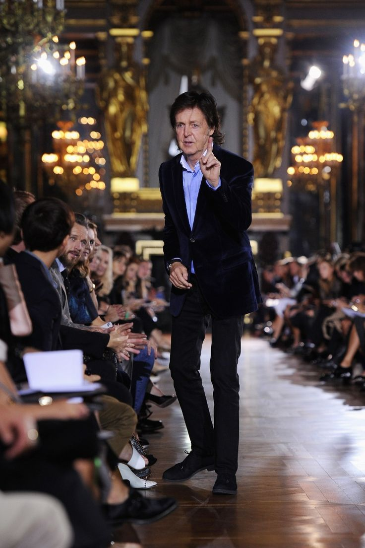 Man on the runway. Sir Paul McCartney�makes his way to his seat at his daughter Stella McCartney's fashion show during Paris Fashion Week on Sept. 30�