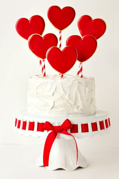 Simple Valentine's Day Cake, love the use of paper straws! We have those red and white striped ones in the store...