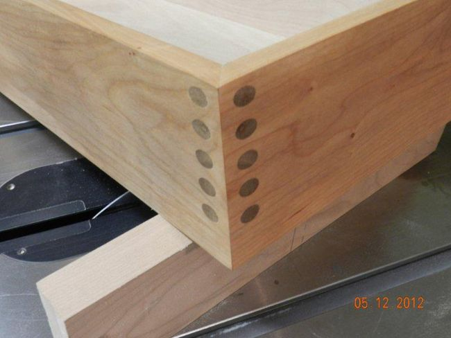 Detail of hall table drawer miter joint made with Dowelmax.