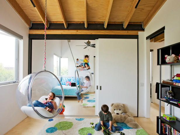 Plan for Play: Hanging bubble chairs and plenty of open floor space create an irresistible indoor play area for kids eliminating rainy-day cries of, 'I'm bored!' Design by Randy Weinstein.