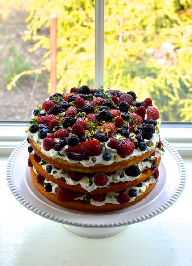 Triple layer berry cake with lemon cream, thyme, and pistachios. A ...