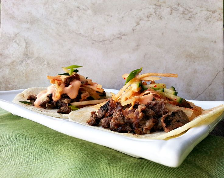 Korean kalbi tacos with pear and kimchi slaw finished with gochujang ...