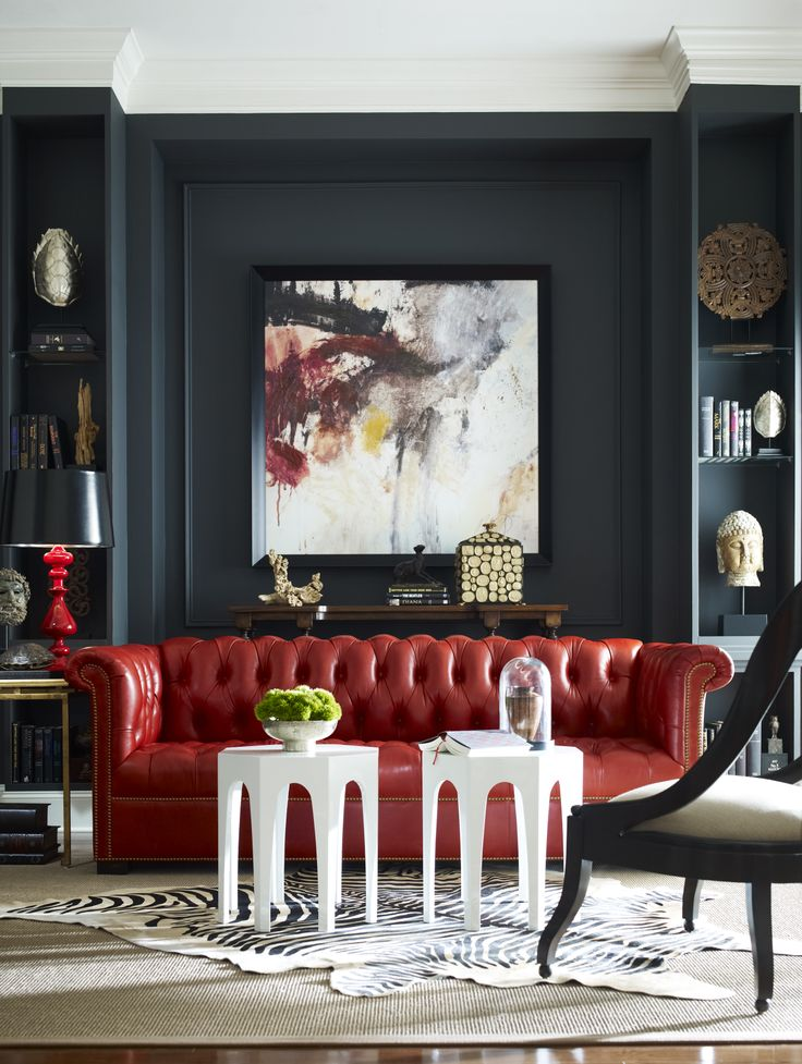 The Bernard sofa, accompanied by accent tables & chair from Emerson et Cie, enhance this eclectic room.