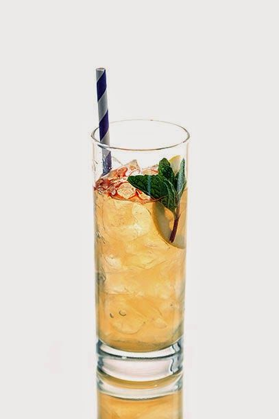 Ginger Swizzle with bourbon, lemon, ginger syrup and herbal yellow ...