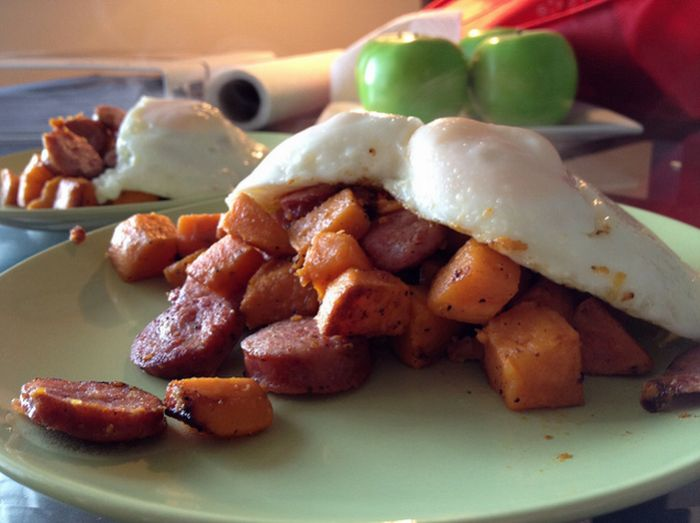 Sweet potato and sausage hash with fried eggs. Paleo food. I find ...