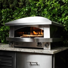 Kalamazoo's countertop oven cooks pizzas from below with it two independently controlled burners and a flame at the back helps browns the top. The oven heats up in 20 minutes, then it takes just two minutes to cook a pizza (six to cook a calzone).