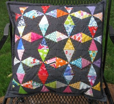 Christmas in July – Kaleidoscope Pillow - by Julie at 627handworks.  Love the scrappy-ness and the different colored hand stitching.