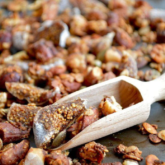 Healthy chunky nut and fig granola with almonds, pecans, hazelnuts and ...