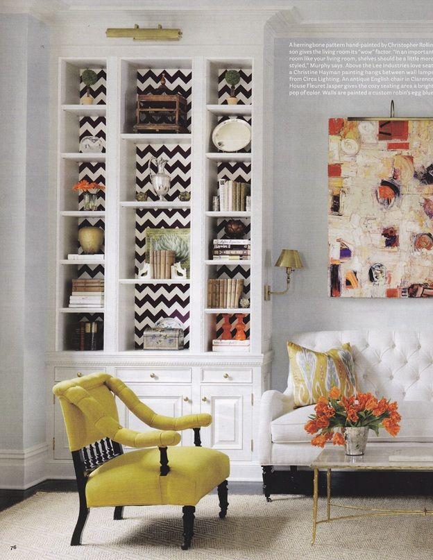 built ins, blue gray walls, brass light fixtures, tufted settee, ...