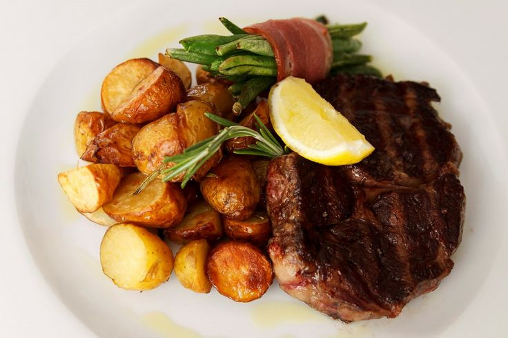 Grilled Argentinian rib-eye steak with coarse sea salt and lemon ...