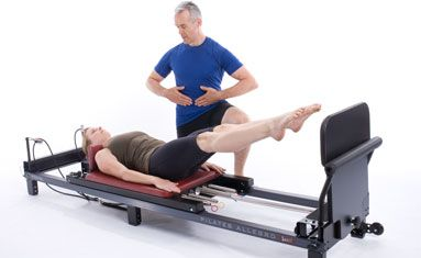 Teaching plyometrics on a reformer jump board.  Want to lose weight and tone fast? Jump Board your way to fitness.