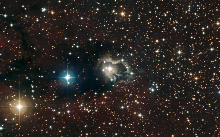 Reflection Nebula - This image, centred on the B[e] star HD 87643, beautifully shows the extended nebula of gas & dust that reflects the light from the star. The central star's wind appears to have shaped the nebula, leaving bright, ragged tendrils of gas & dust. A careful investigation seems to indicate that there are regular ejections of matter from the star every 15-50 yrs. The image was taken with the Wide Field Imager on the MPG/ESO 2.2-metre telescope at La Silla.