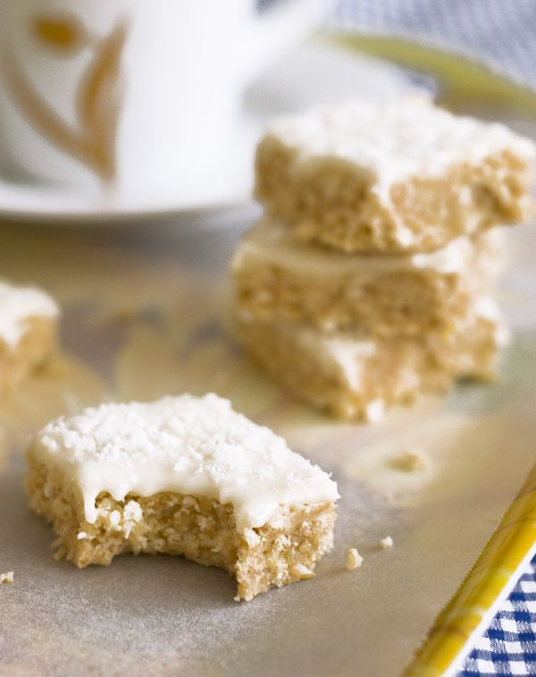 ... lemon coconut slice. A biscuit coconut base with tangy lemon icing