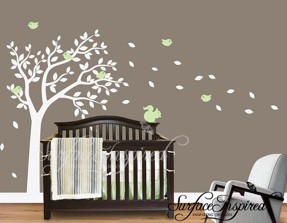 grey walls, white tree, blowing leaves. so cute!