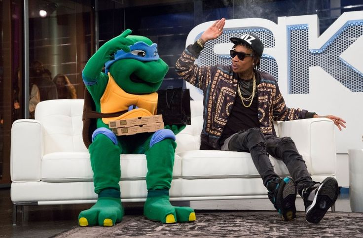 Turtle power! Wiz Khalifa hangs with Leonardo of the Teenage Mutant Ninja Turtles on Nov. 19 in Los Angeles