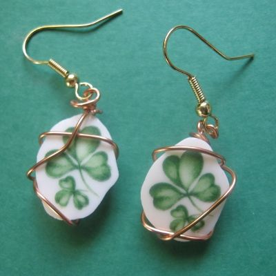 "Irish Shamrock earrings  Wrapped with copper artist wire  Earrings are 1/2"" x 1-1/2"" counting hoops  Price: $29.99"