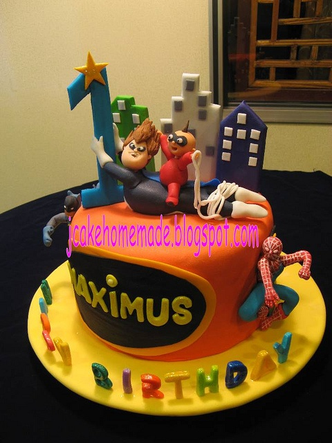 Superhero and The Incredibles theme birthday cake