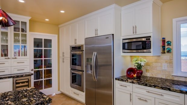 Transitional U shaped Pale Yellow kitchen, white cabinets, $50,000  $