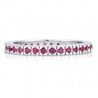 """Lovely CZ eternity band ring is set in sterling silver, plated with rhodium, and stamped with a quality mark """"925″. 33 dazzling 1.5mm round ruby-red cubic zirconia stones weigh 0.5 carat i..."""