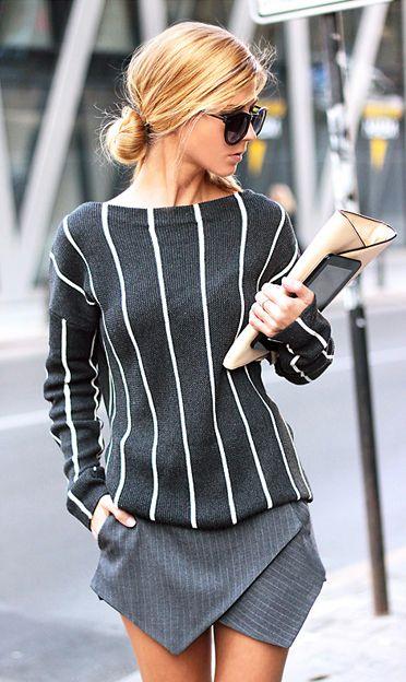 white striped sweater and v shaped mini grey skirt