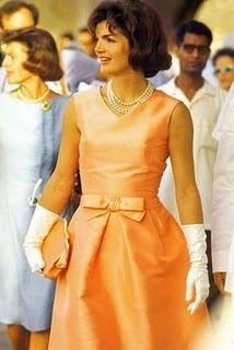 """Jackie Kennedy in Oleg Cassini dress.  Cassini was Mrs. Kennedy's sole designer while she was our first lady.  For my vintage Barbie friends, Barbie had an identical dress, no doubt inspired by this one, called """"Belle"""" dress - in 1962 & 1963 it was made in cotton and silk shantung in 1964.  (http://www.fashion-doll-guide.com/Vintage-Barbie-Fashion-Pak-Belle-Dress.html)"""