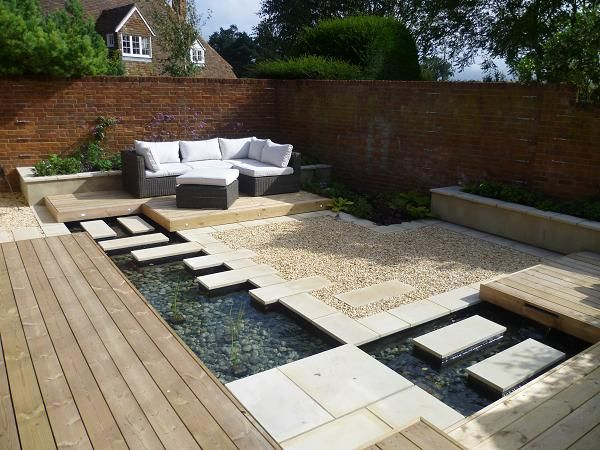Contemporary Courtyard Covering : ... courtyards  Contemporary courtyard - young plants still to cover