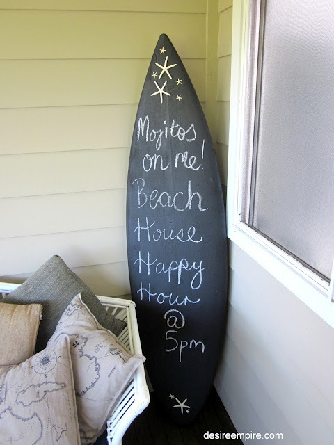 DIY- Great idea for a beach party or wedding! Paint a old surfboard with chalk board paint.