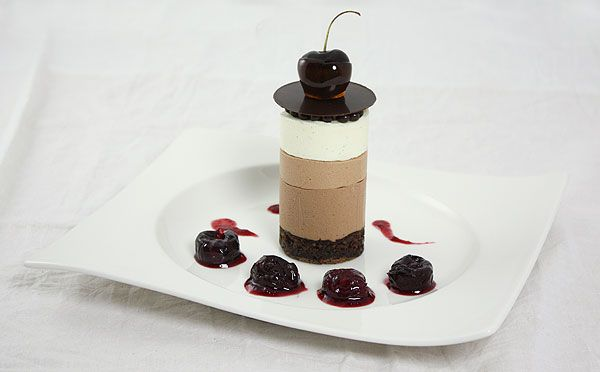 Chocolate Mousse decorated with crispearls, chocolate disc and caramel ...