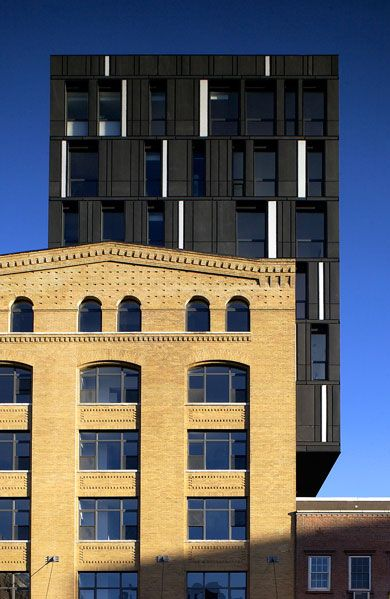 Located in the Meatpacking District of Manhattan, The Porter  House at 66 Ninth Avenue is the renovation and conversion of  a six-story 30,000 sq. ft. warehouse built in 1905 to residential  condominiums. A new 20,000 sq. ft. addition added four  stories to the existing building and an 8 ft. cantilever along the  building's southern exposure.