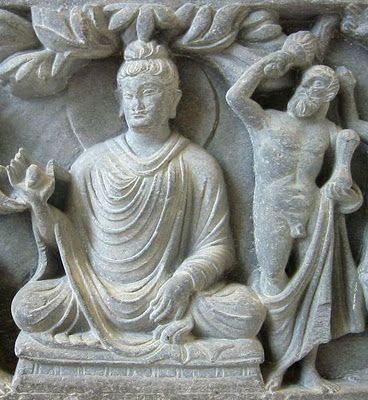 Greco-Buddhist art from Gandhara, 1st century BC. This depicts the Buddha with Heracles (in place of Vajrapani) as his protector bodhisattva. A wonderful cross-cultural masterpiece in the overlapping of Alexander's empire and the Indian empires.