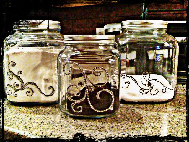 Canisters from hobby lobby, took crystal stickers from the scrapbooking section and decorated them!