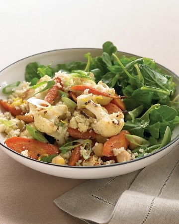 couscous salad with roasted vegetables, chickpeas, lemon, and arugula.