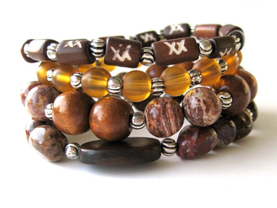 Beautiful Bohemian beaded stretch bracelets featuring 10mm cappuccino beads, 12mm wood beads, hand carved bone beads, 8mm yellow glass beads, rainforest agate chunk beads and pewter beads by Rock & Hardware Jewelry.