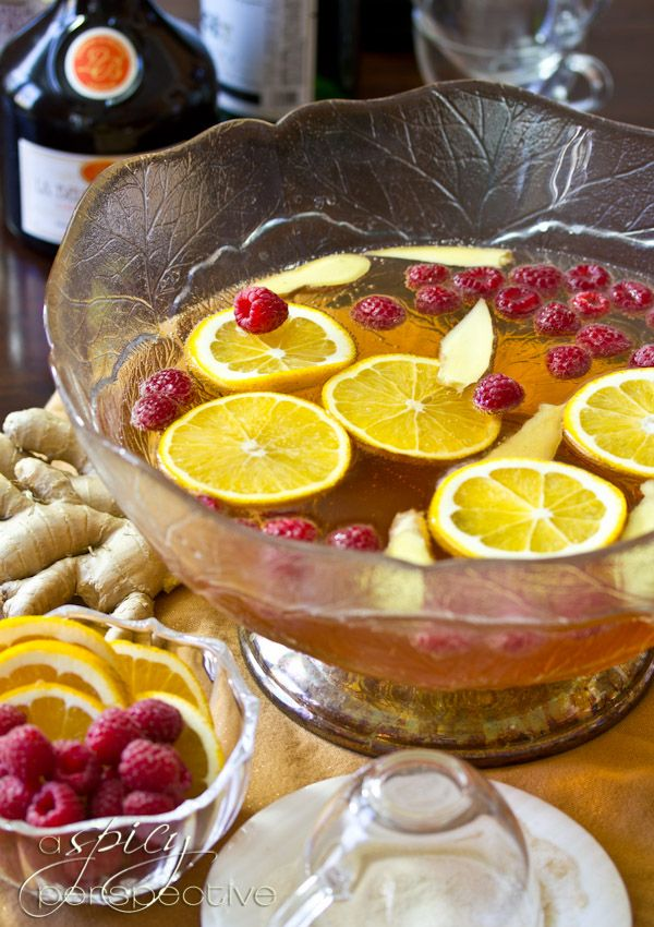 Champagne Punch with Raspberry and Orange Liqueur Ingredients: 6 Tb ...
