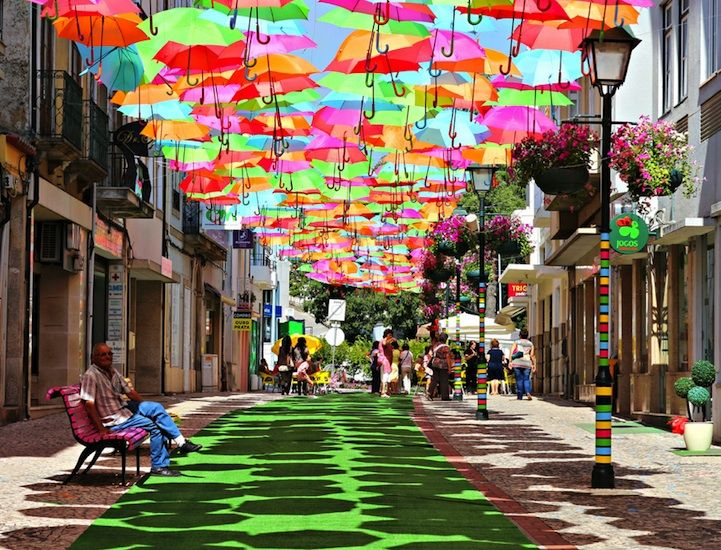 Colorful Umbrellas Magically Float in Mid-Air - My Modern Metropolis. Beira Litoral, Portugal.