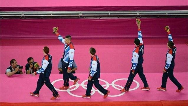 Team GB wave to crowd after winning bronze in men's Artistic Gymnastics.