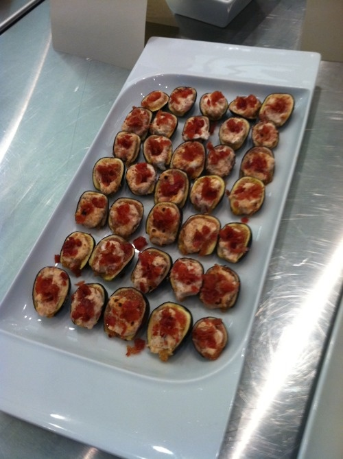 Figs stuffed with goat cheese and topped with bacon