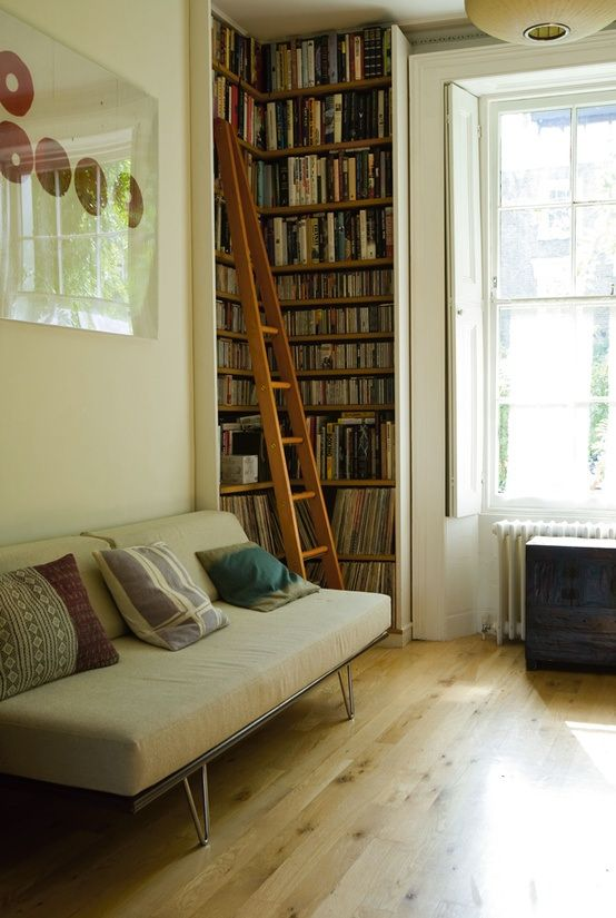 Excellent way to fill an odd corner with lots of book storage. Floor to ceiling...